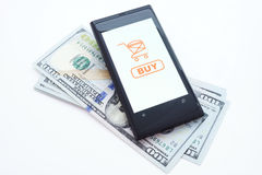 Smartphone with online shopping application on a screen and dollars.  on white background. Modern mobile phone with online shopping application on a screen and Royalty Free Stock Photo