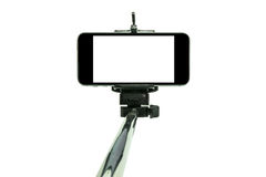 Smartphone op een selfiestok in studio 1 wordt geschoten die Royalty-vrije Stock Afbeelding