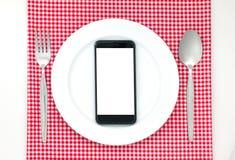 Smartphone op plaat Stock Fotografie