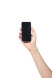 Smartphone på den isolerade kvinnlighanden Royaltyfria Bilder