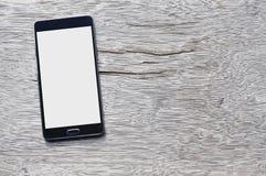 Smartphone på wood bakgrund med kopieringsutrymme Fotografering för Bildbyråer