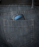 Smartphone in pants pocket. Cell mobile smart phone in back jeans pocket Royalty Free Stock Photography