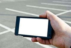 Smartphone and parking lot Stock Images
