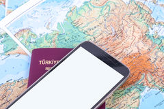 Smartphone and Passport on World Map Royalty Free Stock Images