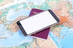 Smartphone and Passport on World Map Stock Images