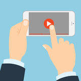 Smartphone with play button. Stock Photos
