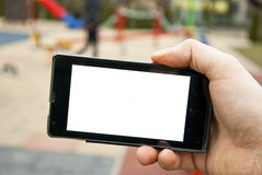 Smartphone and playground Stock Photos