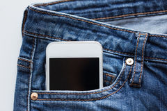 Smartphone in pocket of denim pants or jeans Stock Photos