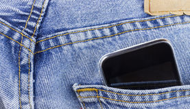 Smartphone in the pocket. Jeans Stock Photo