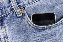 Smartphone in the pocket. Jeans Royalty Free Stock Photos