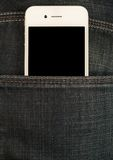 Smartphone in the pocket of jeans Stock Images