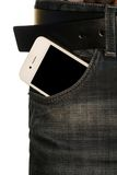 Smartphone in the pocket of jeans Stock Photos