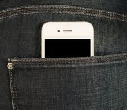 Smartphone in the pocket of jeans Royalty Free Stock Photos