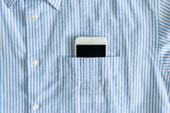 Smartphone in a pocket of shirt. Smartphone with a black screen in a pocket of shirt royalty free stock photo