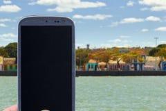 Smartphone at Porto Seguro coast royalty free stock image
