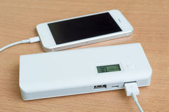 Smartphone with a power bank on desk Stock Image
