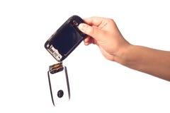 Smartphone preto quebrado na mão do homem. Fotos de Stock