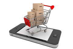 Smartphone and a shopping cart with boxes Royalty Free Stock Photo