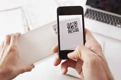 Smartphone QR Code. Smartphone taking photo of QR code Stock Photos