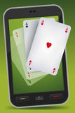 Smartphone que joga - quatro ás Imagens de Stock
