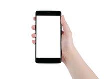 Smartphone que se sostiene derecho adolescente femenino aislado en blanco Fotos de archivo
