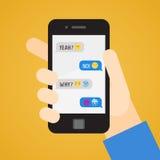 Smartphone räcker in Meddelanden med emoji Del en Arkivbild