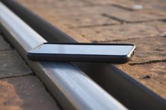 Smartphone on the railroad. royalty free stock photography