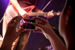 Smartphone recording a musical presentation royalty free stock images