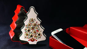 Smartphone In Red Gift Box On Black Background.  Stock Image