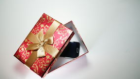Smartphone In Red Gift Box On White Background.  Stock Images