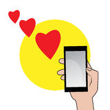 Smartphone with red hearts Royalty Free Stock Photos
