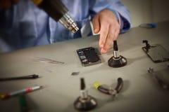 Smartphone-reparatie Stock Foto's