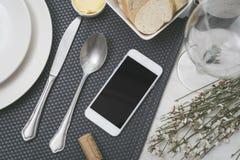 Smartphone restaurant Stock Photography