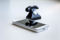 Smartphone and retro telephone Royalty Free Stock Images