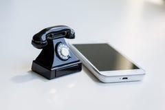 Smartphone and retro telephone Royalty Free Stock Photo