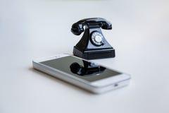Smartphone and retro telephone Stock Photo