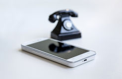 Smartphone and retro telephone Royalty Free Stock Photos