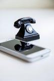 Smartphone and retro telephone Stock Photos