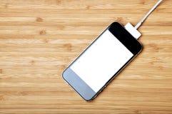 Smartphone ricaricabile Immagini Stock
