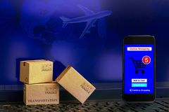 Smartphone runs an online shopping app with cardboard boxes on n Royalty Free Stock Images