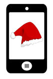 Smartphone with santa hat Royalty Free Stock Image