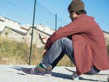 Smartphone-Schlittschuhläufer Stockbild
