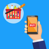 Smartphone screen with buy button and supermarket basket full o. F food. Hand holing smart phone with buy button on the screen. E-commerce flat vector Stock Photo