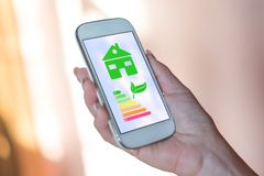 Home energy efficiency concept on a smartphone stock photo