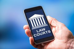 Law courts concept on a smartphone. Smartphone screen displaying a law courts concept royalty free stock image