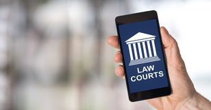 Law courts concept on a smartphone. Smartphone screen displaying a law courts concept stock images