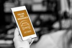 Online car insurance concept on a smartphone. Smartphone screen displaying an online car insurance concept stock photos