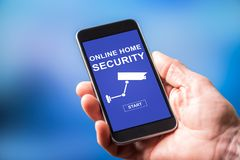 Online home security concept on a smartphone. Smartphone screen displaying an online home security concept royalty free stock photography