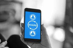Share concept on a smartphone royalty free stock photography
