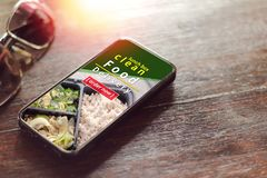 Smartphone screen to order food delivery. Smartphone screen to order food delivery, order lunch box online Stock Photos